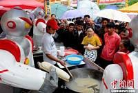 Toca Comer. Robots reemplazan en restaurantes chinos a chefs. Marisol Collazos Soto, Rafael Barzanallana